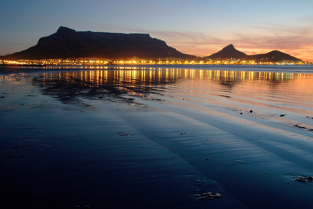 Table Mountain at sunset behind Cape Town
