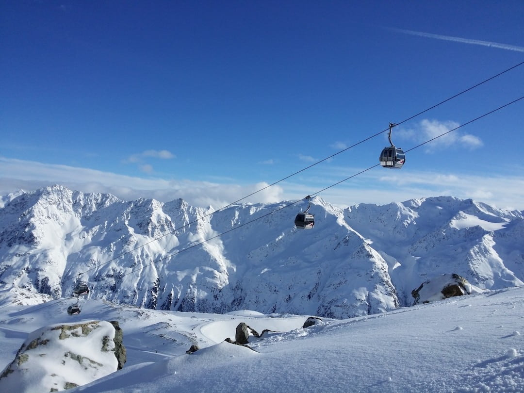 Cable cars journey across Tyrol's snowy landscape