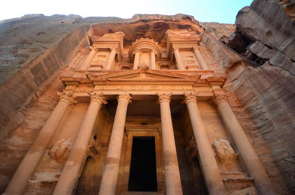 Shot of the pale orange ancient architecture of Petra