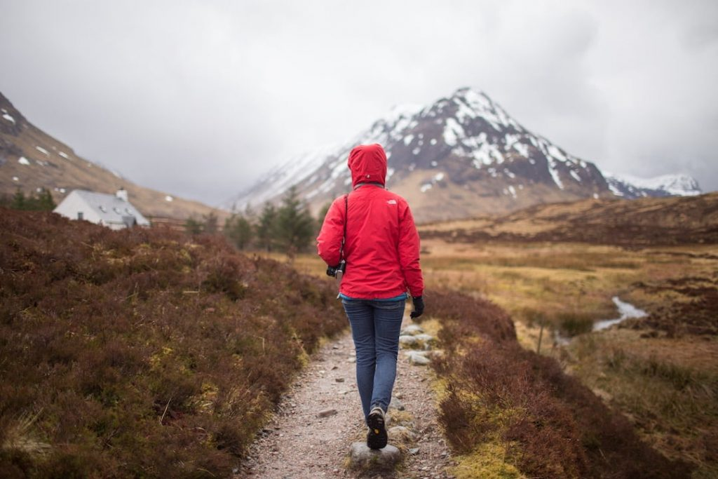 A person on a trail in the Scottish highlands