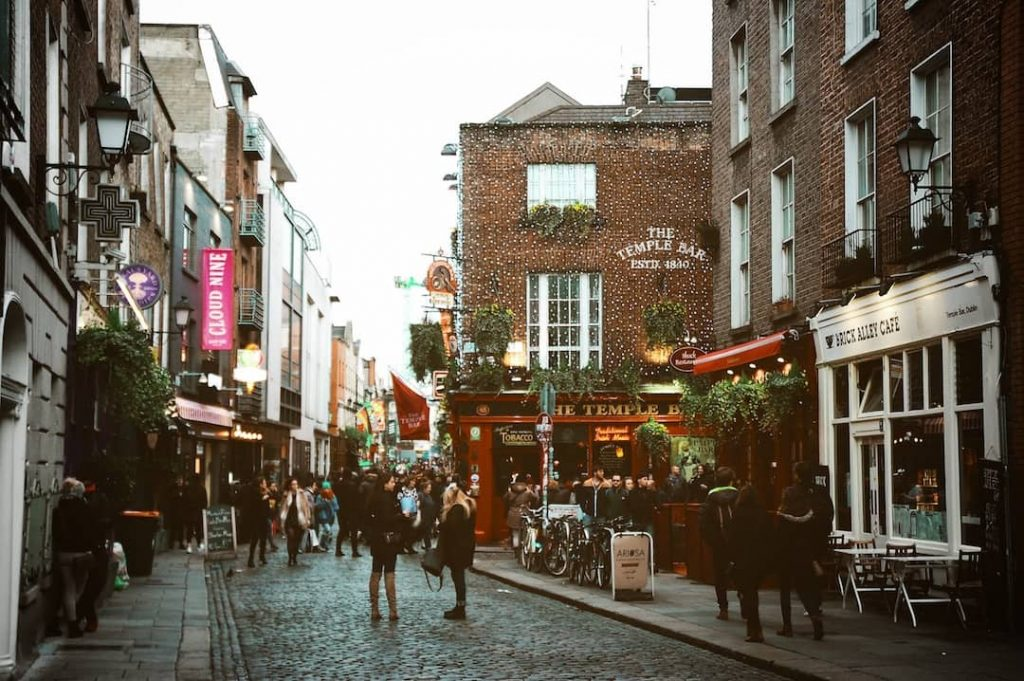 The street in Dublin where the famous Temple Bar is, people can be seen congregating along the cobbled road