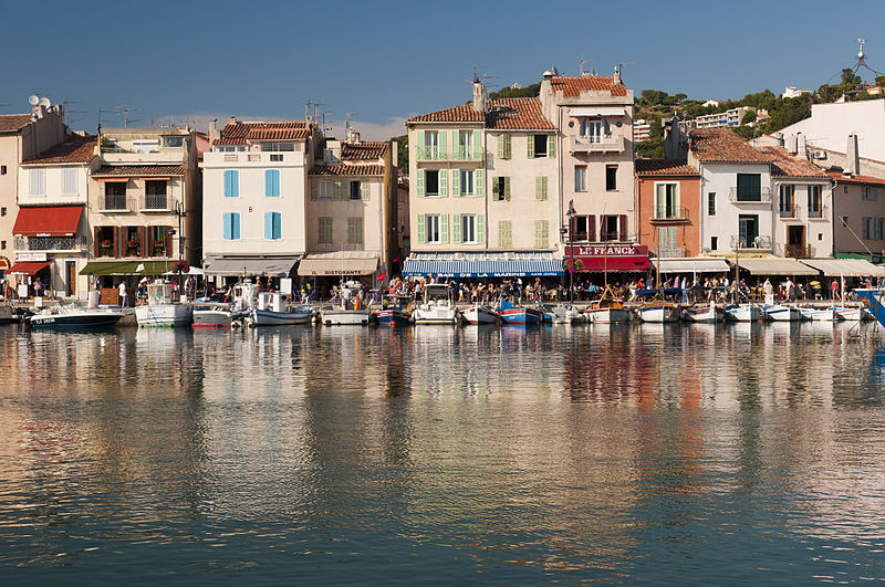 A row of colourful waterfront restaurants in Cassis