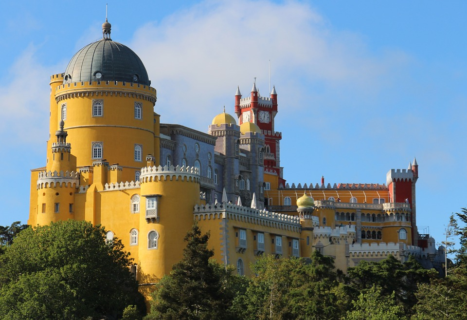 Pena Palace, a bright yellow colour palace in Sintra surrounded by trees