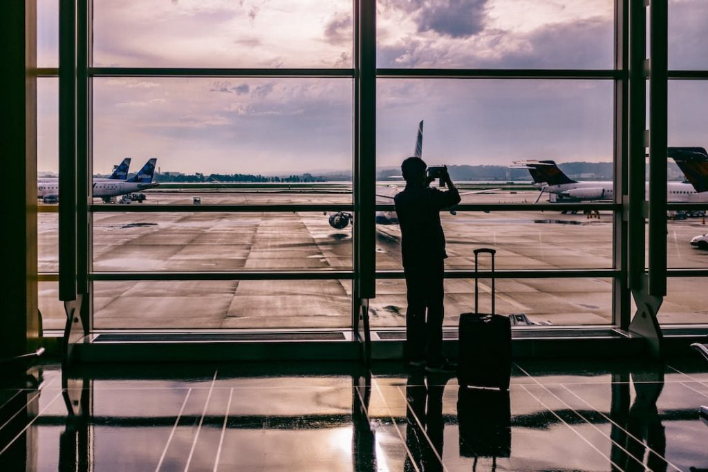 Man at window - long flight accessories