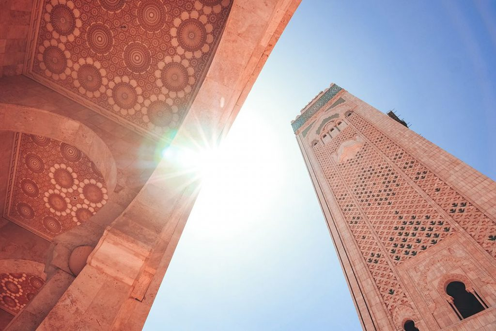 The tower of Hassan II Mosque featuring stunning Moroccan artisanship and design