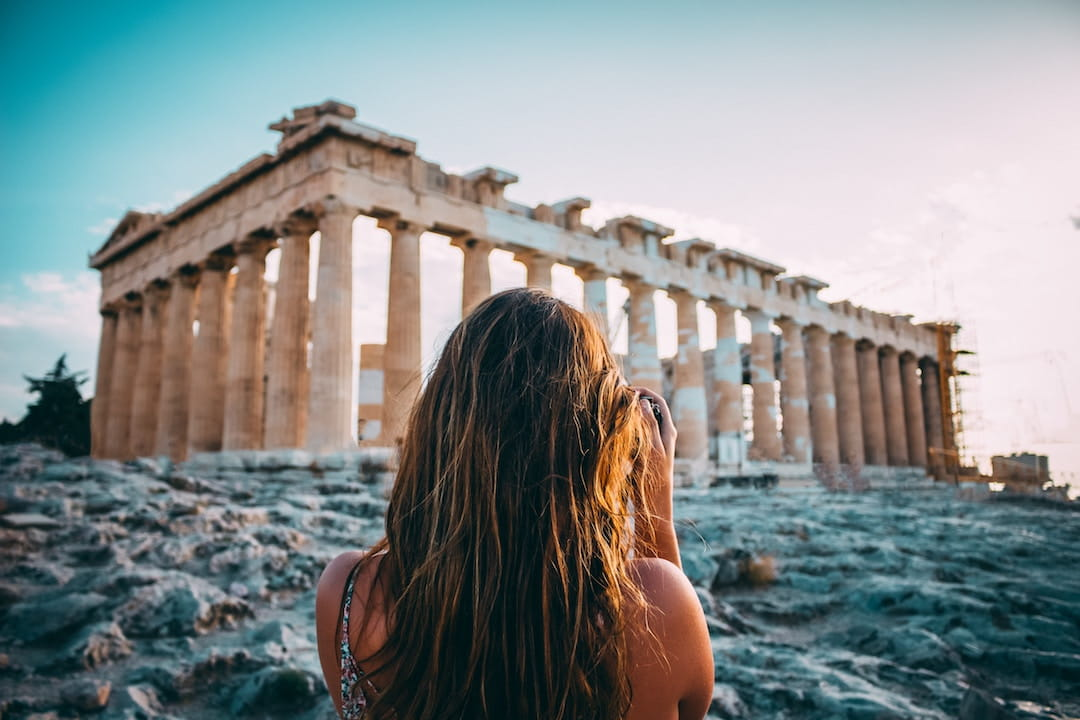 Girl photographing ruins - Summer in Greece