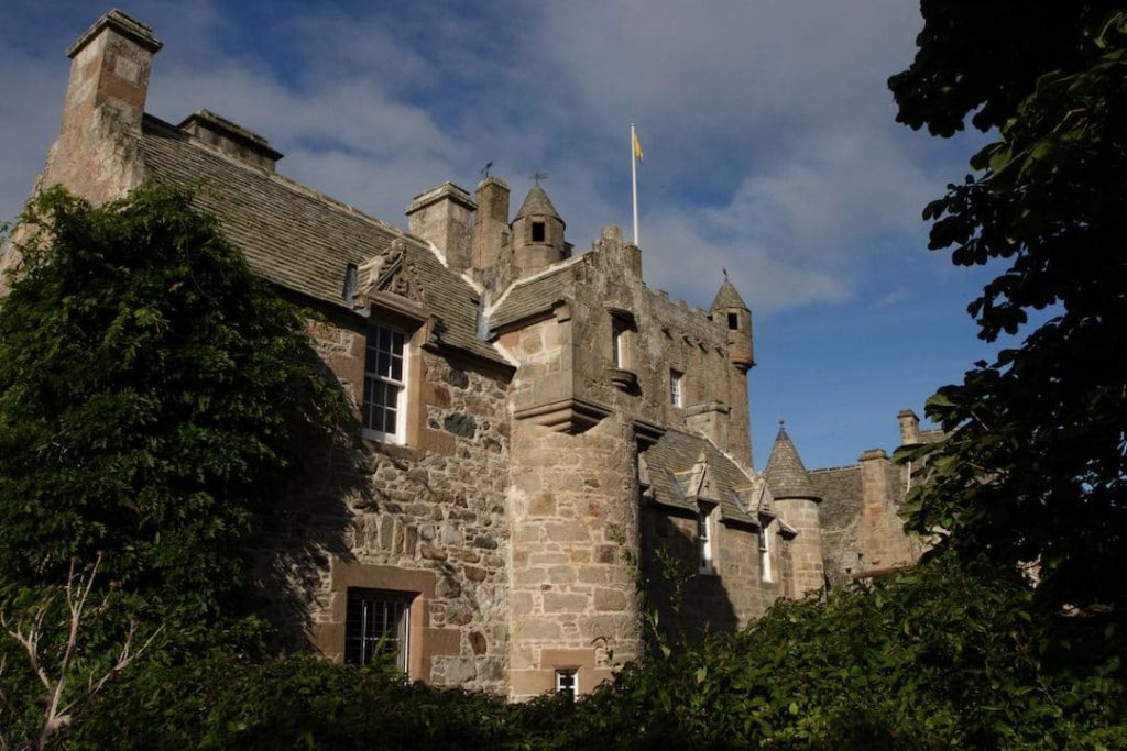 Looking up at Cawdor Castle on a cloudy day