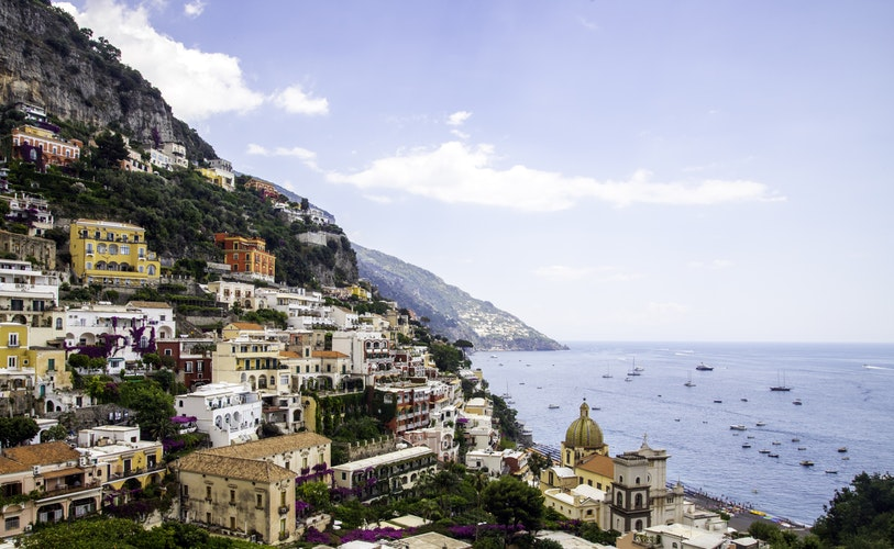 A view of colourful rows of houses from Viale Pasitea in Positano, Italy