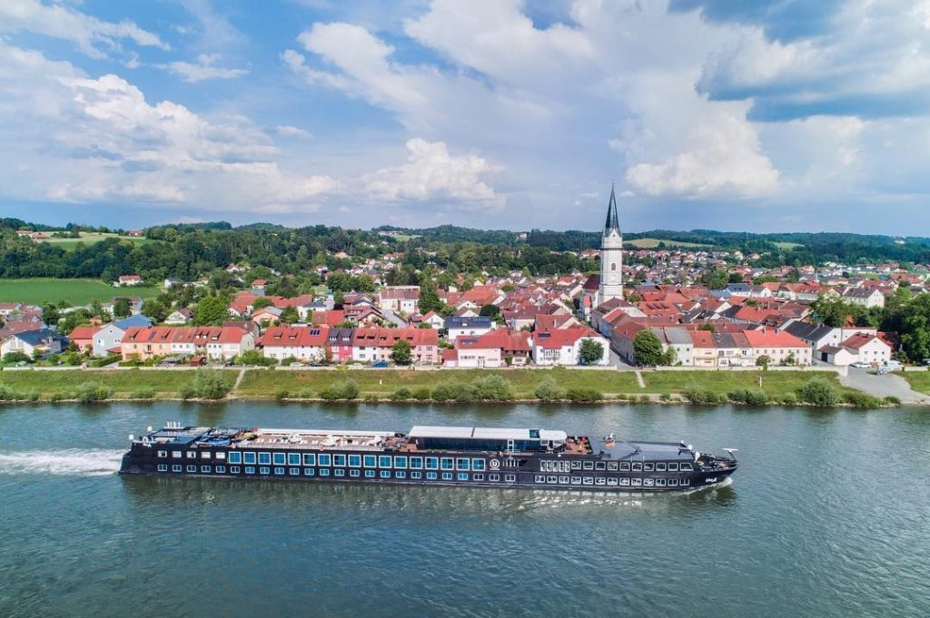 A sleek ship on a river cruise in Europe