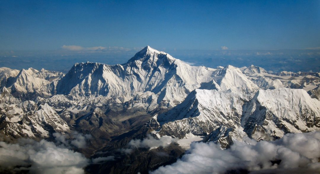 Mount Everest and the Himalayan mountain range as seen from an aircraft in Bhutan. The aircraft is south of the mountains, facing north