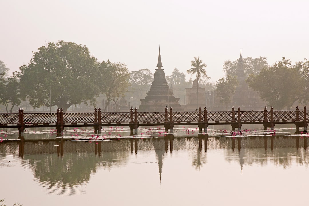 A temple reflecting on the water at dawn at Sukhothai Historical Park
