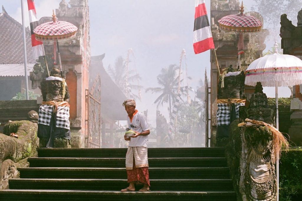 an older man stands on steps in Ubud, Indonesia