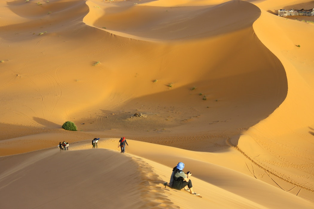 Desert Hiking Essentials: A group of hikers in the Sahara Desert