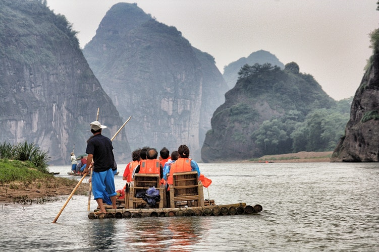a boat with visitors sails along the dragon river