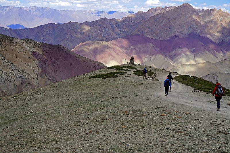 Descending Ganda La Pass , a purplish green mountain trail in India