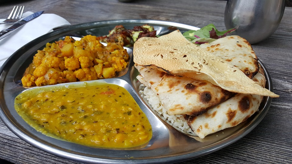 A taal of Indian cuisine: chickpea curry, naan, daal