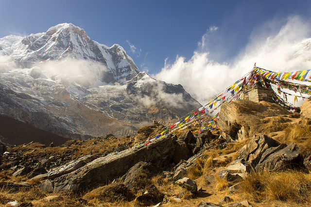 colourful flags at Annapurna Base Camp, Nepal with the mountain massif in the background