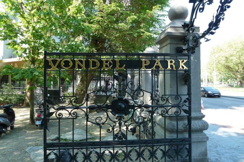 """A black iron gate with the words """"vondel park"""" in gold letters in Amsterdam"""