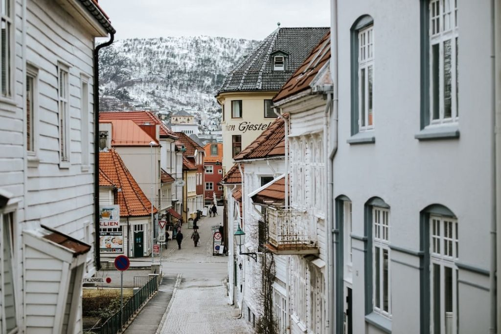 A narrow street with a mountain in the background in Norway