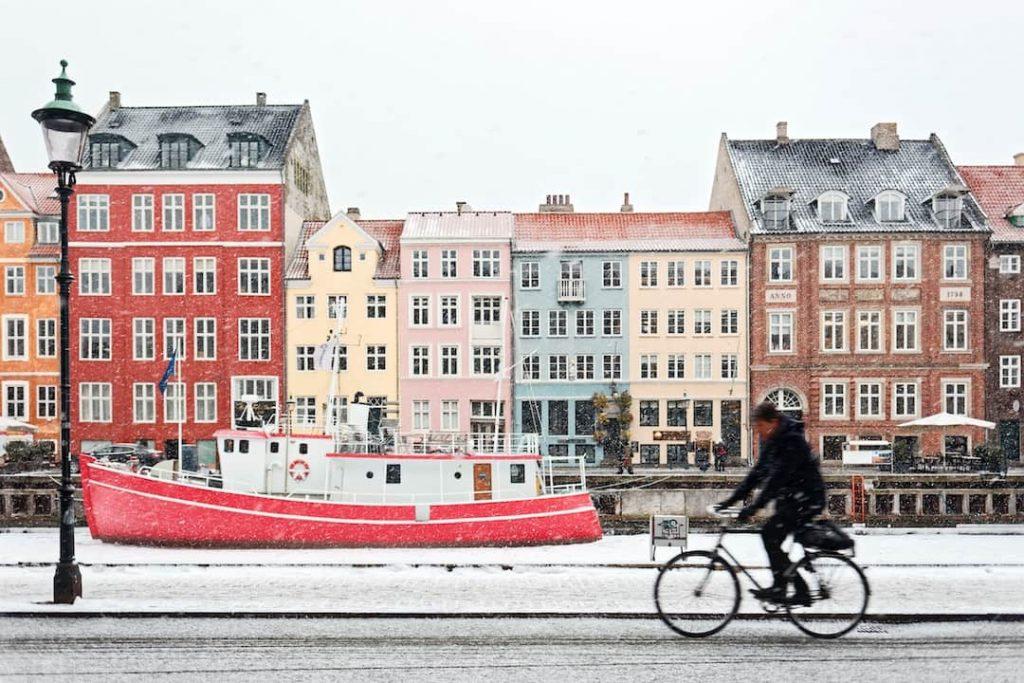 a row of multicoloured houses on a canal in Denmark