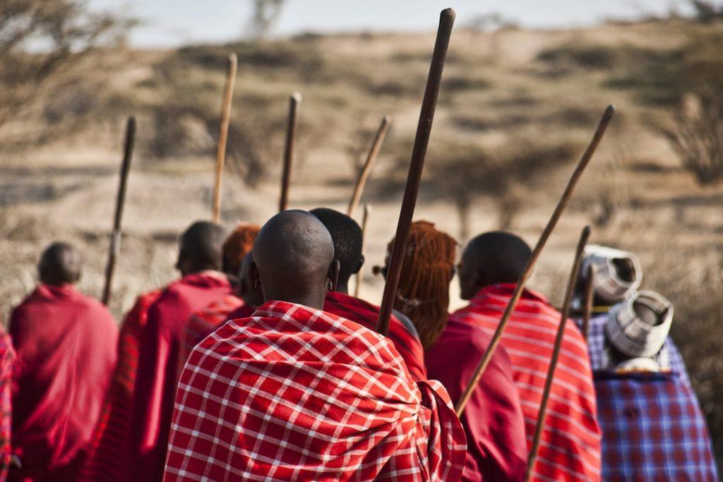 A group of Maasai people in Tanzania wearing red cloaks