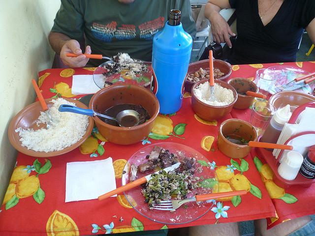 People sharing Feijoada in Brazil