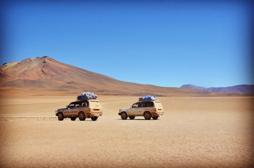 Two cars in Bolivia in the desert