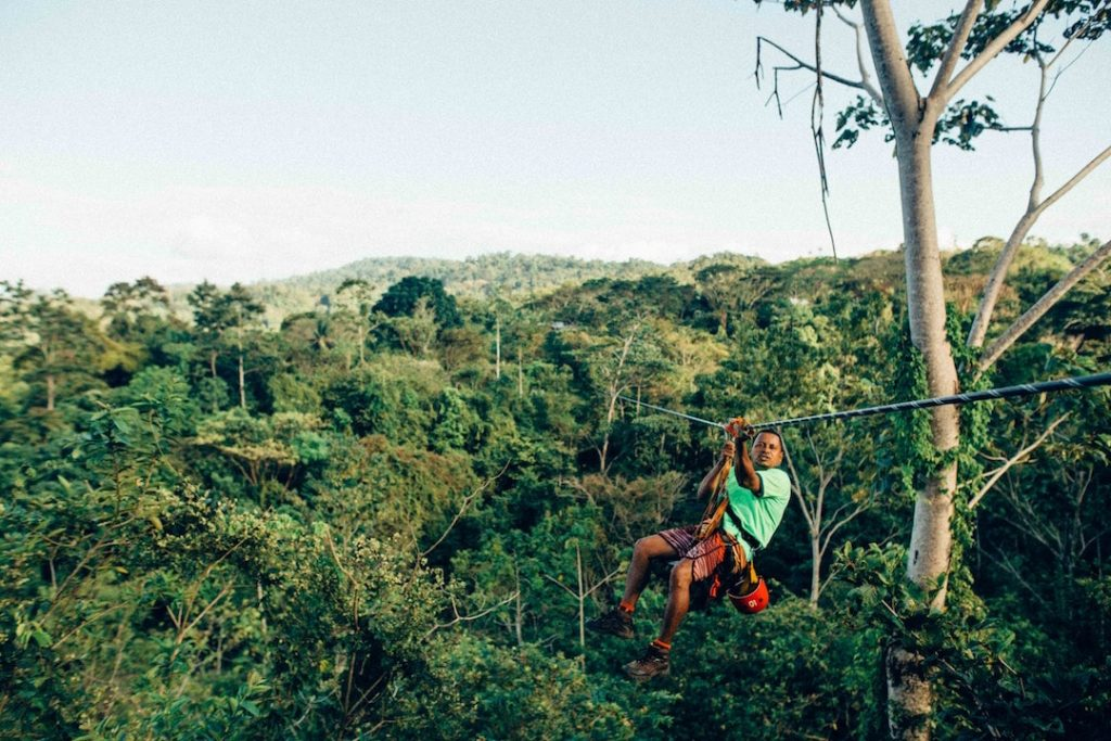 A person ziplining across the trees in Costa Rica