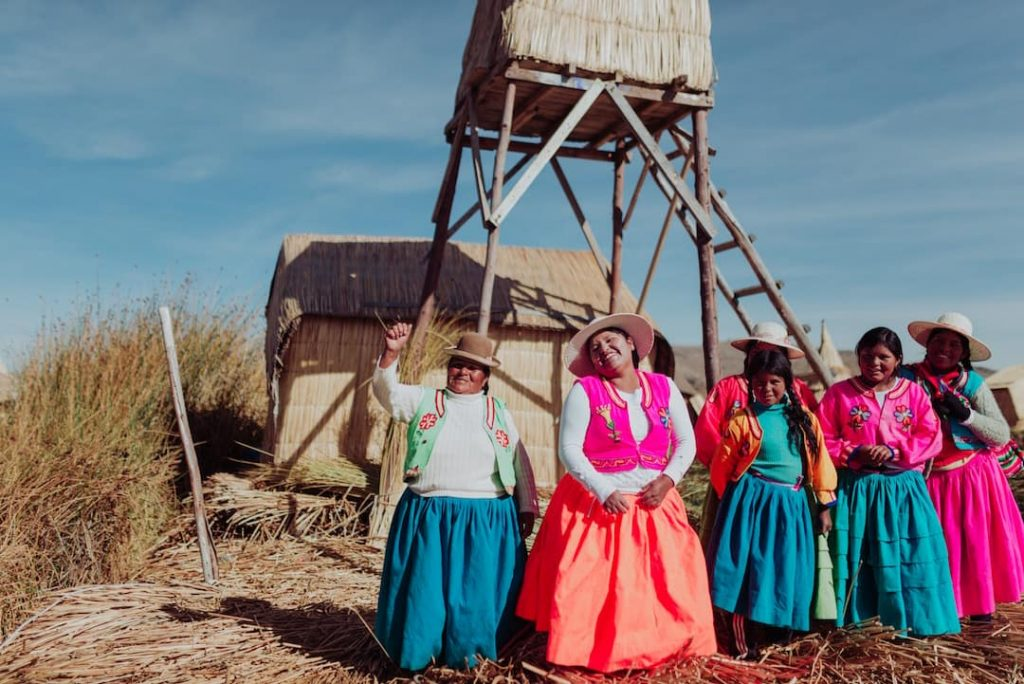 A row of women in colourful traditional outfits, Lake Titicaca