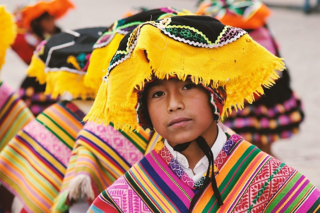 A young person dressed in traditional outfit in Cusco Peru