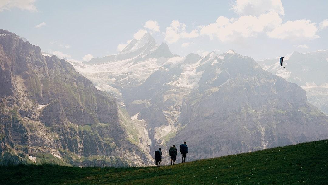 Three people walking in Switzerland