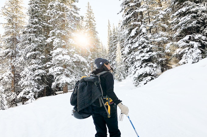 A woman cross-country skiing on the Mayflower Gulch Trail, Frisco, US