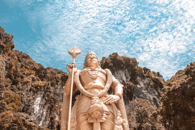 A large gold statue in front of the batu caves, Malaysia