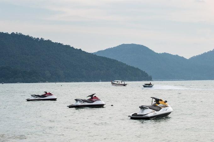 Jetskis on the water in Batu Feringgi, Malaysia