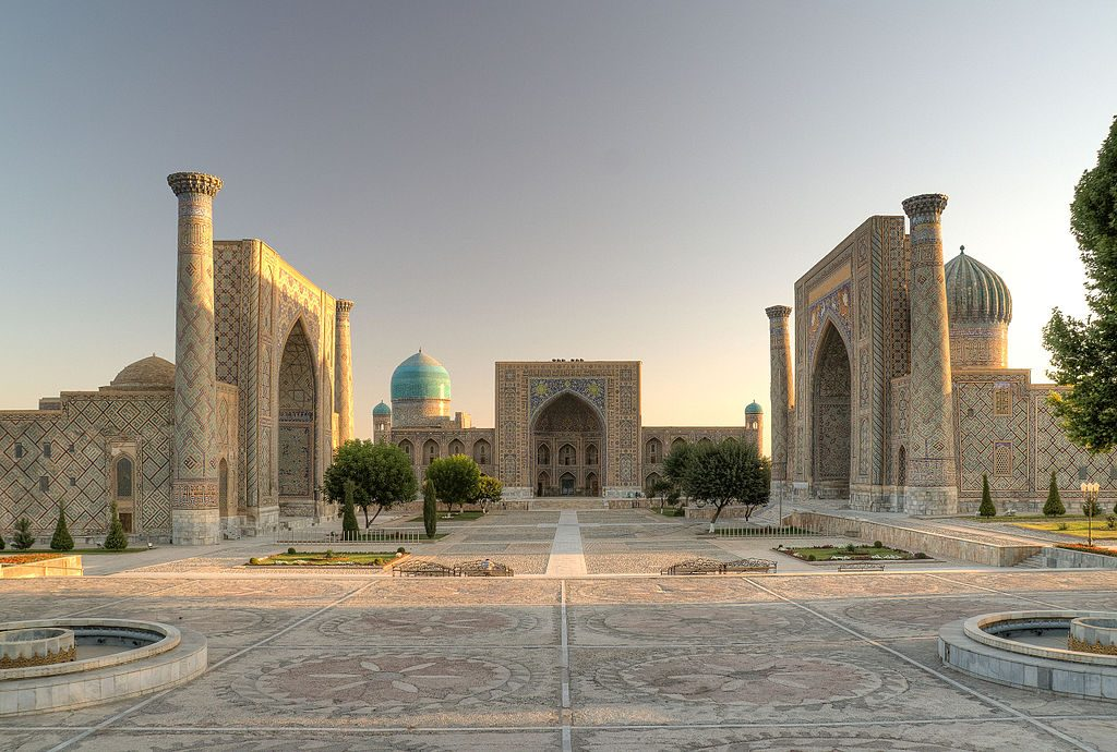 traditional and ornate architecture in Uzbekistan: domes, pillars and archways covered with intricate details