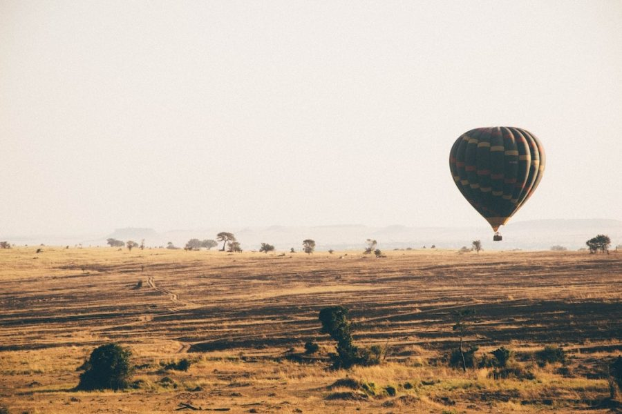 A hot air ballon hovering over the Serengeti National Park