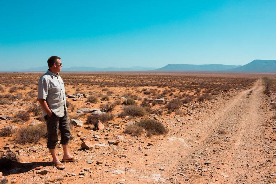 A man standing in Africa looking out into the distance