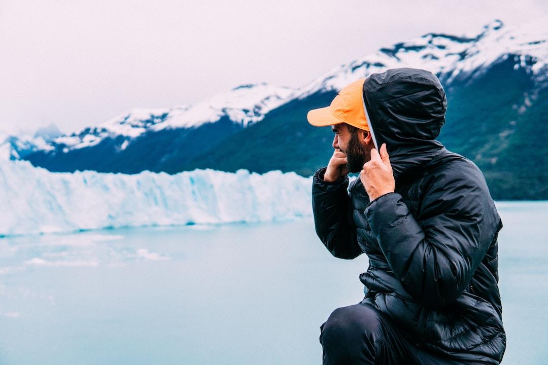 man looking at glacier