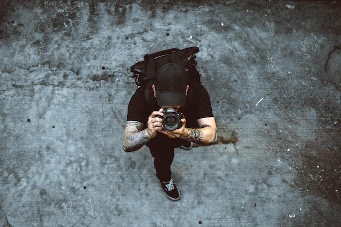 An arial shot of a man taking a photo