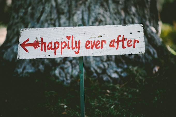 A painted sign that says happily ever after