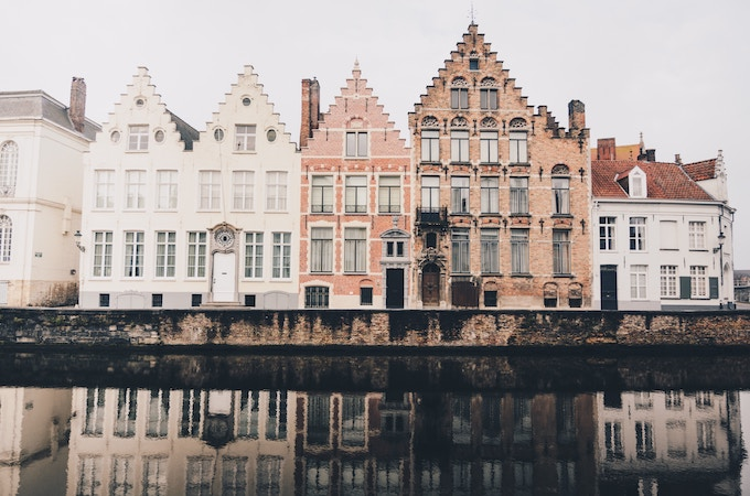 Buildings along a canal in Bruges, Belgium