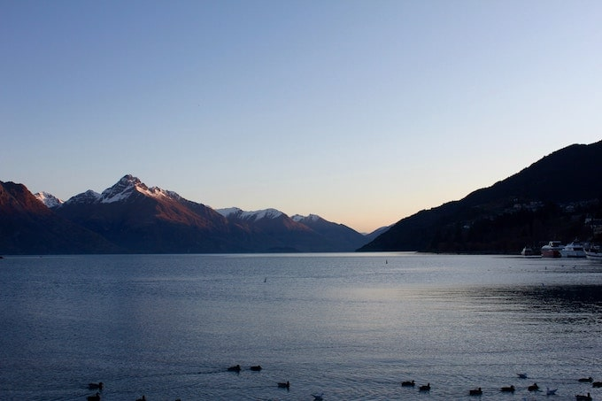 A lake surrounded by mountains in Queenstown, New Zealand