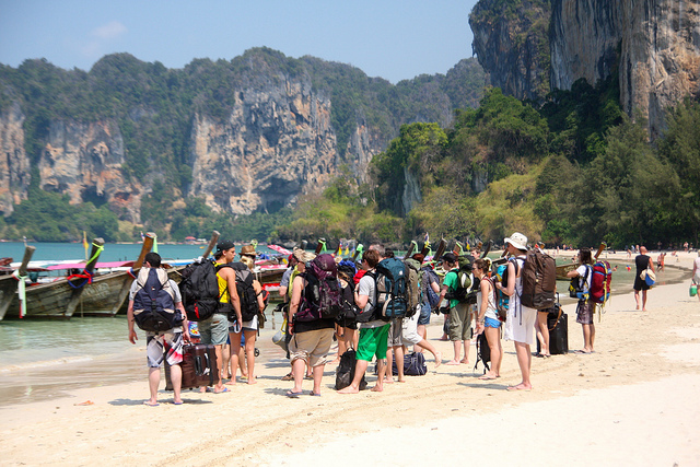 a group of backpackers on a thailand beache
