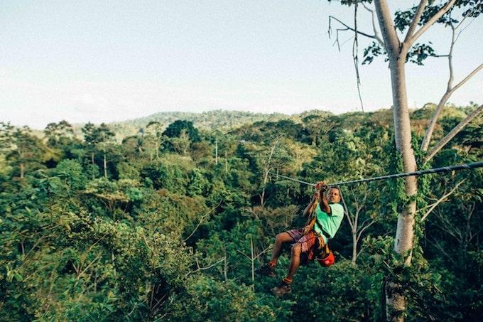 A man ziplining in costa rica
