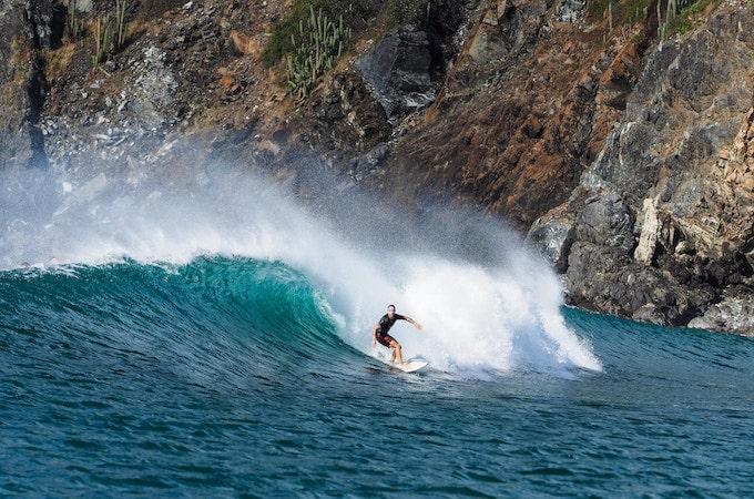A man surfing in costa rica