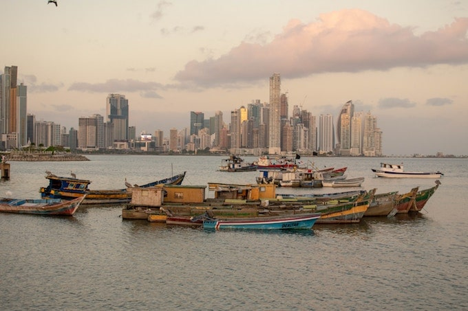 Boats in the ocean against the panama city skyline