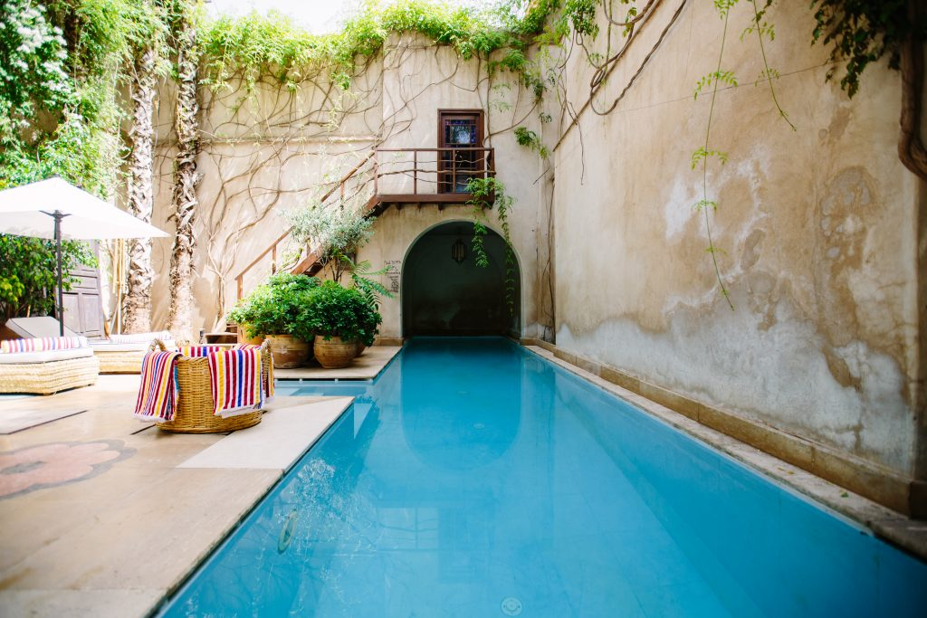 an indoor stone pool in a courtyard
