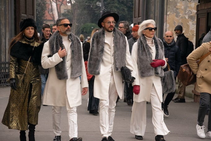 Three people in white suits in Florence, Italy