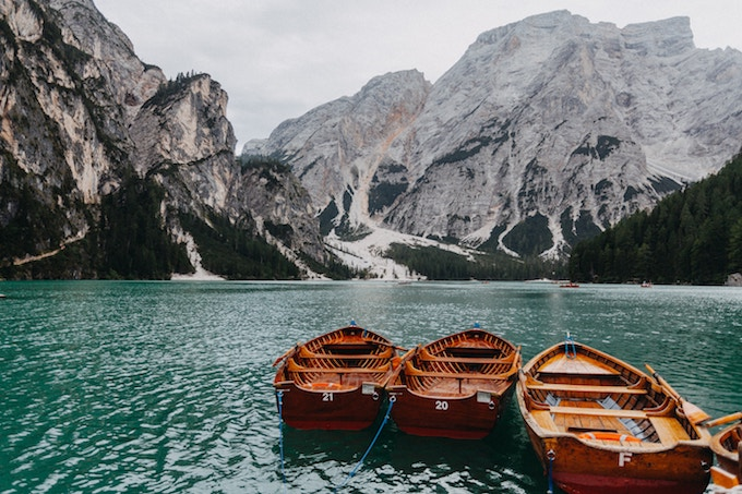 Three boats on a lake in Italy