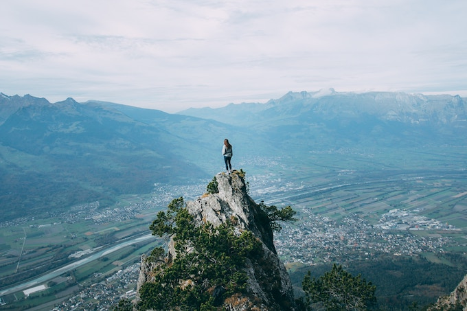 A lone figure standing on a cliff in Liechtenstein